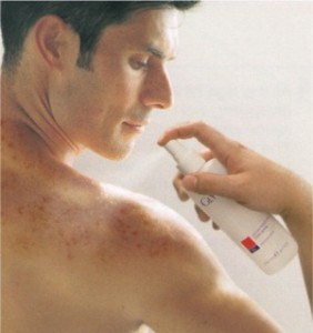 What_Causes_Back_Acne_and_How_Can_You_Get_Rid_of_It man spraying back