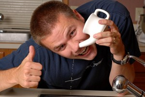 What is a Neti Pot and Why do You Need One guy using a pot