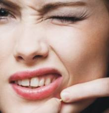 Is There Just One Best Acne Treatment popping a zit